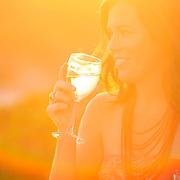 Cap Cana, Dominican Republic - April 12: A woman drinks wine in Cap Cana, Dominican Republic, April 12, 2007.