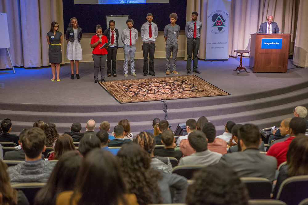 Purchase, NY – 31 October 2014. Early College High School presenters on stage. (Left to right: Jamely Marte, Daniela Amponsah, Jamika Holmes, Victoria Rainford,  Ryan Colon,  Daniel Meed,  Justice Medina, Sean Coley.) The Business Skills Olympics was founded by the African American Men of Westchester, is sponsored and facilitated by Morgan Stanley, and is open to high school teams in Westchester County.