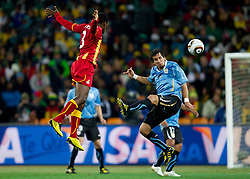Asamoah Gyan of Ghana vs Mauricio Victorino of Uruguay  during to the 2010 FIFA World Cup South Africa Quarter Finals football match between Uruguay and Ghana on July 02, 2010 at Soccer City Stadium in Sowetto, suburb of Johannesburg. (Photo by Vid Ponikvar / Sportida)