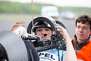 De vrouwelijke rijder Christien Veelenturf in de VeloX4. In Soesterberg test het Human Power Team Delft en Amsterdam (HPT) voor het eerst met de nieuwe fiets, de VeloX4. Op de voormalige vliegbasis legt de recordfiets de eerste meters af. In september wil het HPT, dat bestaat uit studenten van de TU Delft en de VU Amsterdam, een poging doen het wereldrecord snelfietsen te verbreken, dat nu op 133,8 km/h staat tijdens de World Human Powered Speed Challenge.<br /> <br /> In Soesterberg the Human Power Team Delft and Amsterdam (HPT) tests their newest bike, the VeloX4. On the track of the former military airport the bike rides its first meters. With the special recumbent bike the HPT, consisting of students of the TU Delft and the VU Amsterdam, also wants to set a new world record cycling in September at the World Human Powered Speed Challenge. The current speed record is 133,8 km/h.Nederland, Soesterberg, 08-05-2014