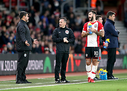 Southampton's Charlie Austin (right) argues with Huddersfield Town manager David Wagner about goalkeeper Jonas Lossl's injury during the Premier League match at St Mary's, Southampton.