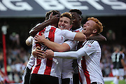 Brentford forward Scott Hogan (9)  celebrating with team mates after scoring 1-0 during the EFL Sky Bet Championship match between Brentford and Nottingham Forest at Griffin Park, London, England on 16 August 2016. Photo by Matthew Redman.