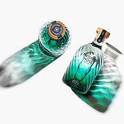 A studio product showcasing the new design of the bottle of Twisted Nose gin, captured by photographer Stuart Freeman.