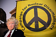 CND at the No to Trump, No to NATO, Hands off our NHS Demonstration on 3rd December 2019 in London, United Kingdom. Donald Trump is visiting London or the NATO Heads of State summit on the 70th anniversary of the organisation, which the Queen will be hosting a reception for NATO leaders at Buckingham Palace. Meanwhile, there is fear that Boris Johnson and Donald Trump will be in discussion about opening up the NHS to US corporations. Organisers were Together Against Trump which is a collaboration between the Stop Trump Coalition and Stand Up To Trump.