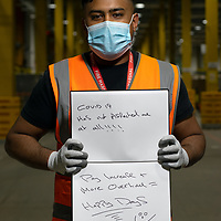 Saiyad Rohman trained me to use a pump truck. He is pictured Inside Amazon Fulfillment Center Man 3 Near Bolton.  He has worked at Amazon for 18 months, He is from Oldham. He was asked to write two ways she felt the COVID 19 Lockdown had impacted himself.