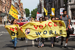 London, UK. 1 June, 2019. Members of the United Voices of the World (UVW) and Independent Workers of Great Britain (IWGB) and  grassroots trade unions march to the DoubleTree Hilton Hotel to protest in solidarity with Dalia Quinonez Guerrero, a former cleaner from whom wages were withheld. The protest was previously arranged to have taken place outside Chanel but arrangements were changed after the global fashion chain agreed to pay its cleaners the London Living Wage at its stores.