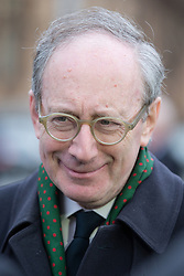 © Licensed to London News Pictures . 16/01/2014 . Salford , UK . Sir Malcolm Rifkind , MP for Kensington  , after the service . The funeral of Labour MP Paul Goggins at Salford Cathedral today (Thursday 16th January 2014) . The MP for Wythenshawe and Sale East died aged 60 on 7th January 2014 after collapsing whilst out running on 30th December 2013 . Photo credit : Joel Goodman/LNP