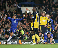 Photo: Lee Earle.<br /> Chelsea v Wigan Athletic. The Barclays Premiership.<br /> 10/12/2005. Chelsea's Hernan Crespo (L) celebrates as John Terry (R) gets up off the ground after heading home the only goal of the game.