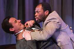 "© Licensed to London News Pictures. 15/01/2014. London, England. L-R: Peter Lloyd as Iago and Stefan Adegbola as Othello. The Shakespearean tragedy ""Othello: The Moor of Venice"" opens at the Riverside Studios in Hammersmith, London in a ""Film Noir"" setting. Directed by Rebekah Fortune with Stefan Adegbola as Othello and Gillian Saker as Desdemona. Running form 15 January to 18 February 2014. Photo credit: Bettina Strenske/LNP"