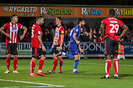AFC Wimbledon midfielder Anthony Wordsworth (40) celebrating AFC Wimbledon striker Kweshi Appiah (9) scoring goal during the EFL Sky Bet League 1 match between AFC Wimbledon and Lincoln City at the Cherry Red Records Stadium, Kingston, England on 2 November 2019.