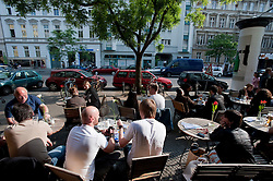 Pavement cafe on trendy Bergmannstrasse in Kreuzberg Berlin Germany
