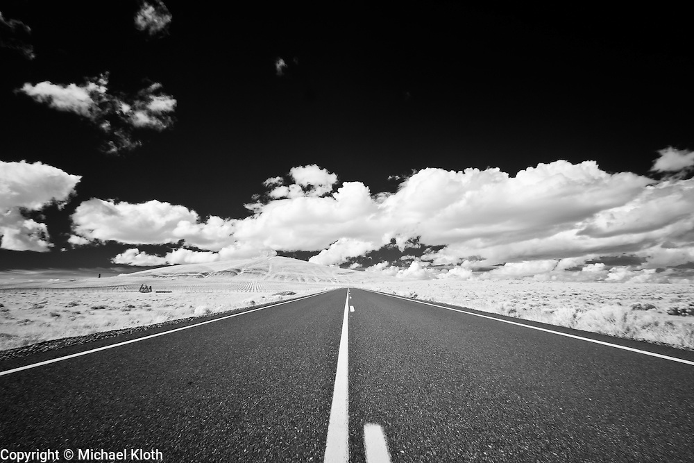 Infrared (IR) image - Eastern Washington high desert landscape.  The road provides symmetry to this image on both the vertical and horizontal axises.