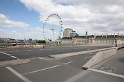 Westminster Bridge looking towards the London Eye, is eerily quiet, devoid of traffic, and silent on empty streets as lockdown continues and people observe the stay at home message in the capital on 11th May 2020 in London, England, United Kingdom. Coronavirus or Covid-19 is a new respiratory illness that has not previously been seen in humans. While much or Europe has been placed into lockdown, the UK government has now announced a slight relaxation of the stringent rules as part of their long term strategy, and in particular social distancing.