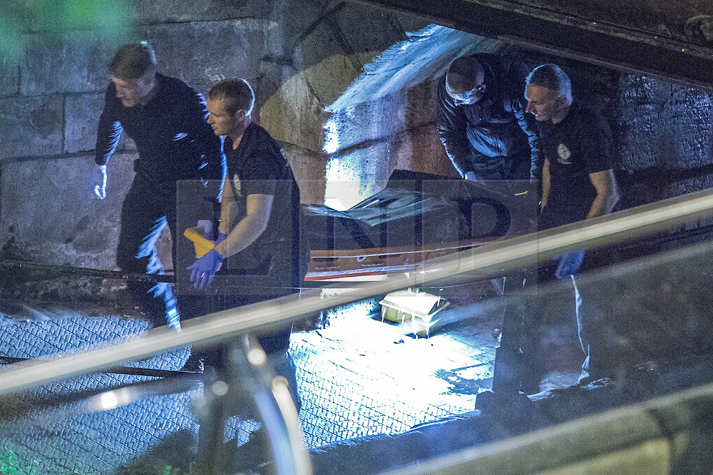 """© Licensed to London News Pictures . Manchester , UK . FILE PICTURE DATED  06/10/2013 of police carrying a body , found floating in a canal . Police pulled a body from The Bridgewater Canal in Manchester , adjacent to the City's """" Gay Village """" on Canal Street . Greater Manchester Police have issued a statement after suggestions that a number of deaths in and around Manchester's canals may be linked to a serial killer , named in local folklore as """" The Pusher """" . The statement said """" Absolutely no evidence whatsoever of foul play has been established """" . Photo credit : Joel Goodman/LNP"""