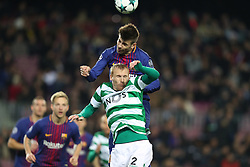 December 5, 2017 - Barcelona, Catalonia, Spain - GERARD PIQUE of FC Barcelona heads the ball under pressure from JEREMY MATHIEU of Sporting CP during the UEFA Champions League, Group D football match between FC Barcelona and Sporting CP on December 5, 2017 at Camp Nou stadium in Barcelona, Spain. (Credit Image: © Manuel Blondeau via ZUMA Wire)