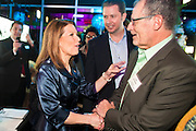 """11 DECEMBER 2011 - SCOTTSDALE, AZ:    Congresswoman and Republican Presidential hopeful MICHELE BACHMANN (R-MN) greets TOM MORRISSEY, Chairman of the Arizona Republican Party, at a fundraiser sponsored by Politics on the Rocks at the Mint in Scottsdale, Sunday. The Mint is a popular bar and restaurant built in a former bank in Scottsdale, AZ. Politics on the Rocks was started by Charles A. Jensen in Scottsdale, Arizona. The purpose of """"Politics on the Rocks"""" is to bring Republican & Conservative Professionals together in a monthly happy hour where they can network, socialize, and hear directly from prominent politicians and successful business leaders.      PHOTO BY JACK KURTZ"""