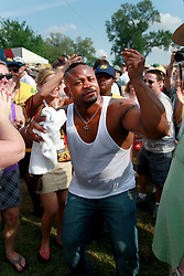 27 April 2013. New Orleans, Louisiana,  USA. .New Orleans Jazz and Heritage Festival. Dwayne Dopsie jumps from the stage into the crowd at the Fais Do-Do stage..Photo; Charlie Varley.