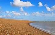 Steep beach profile sediment calm water blue sky white clouds landscape, Shingle Street, Suffolk, England, UK
