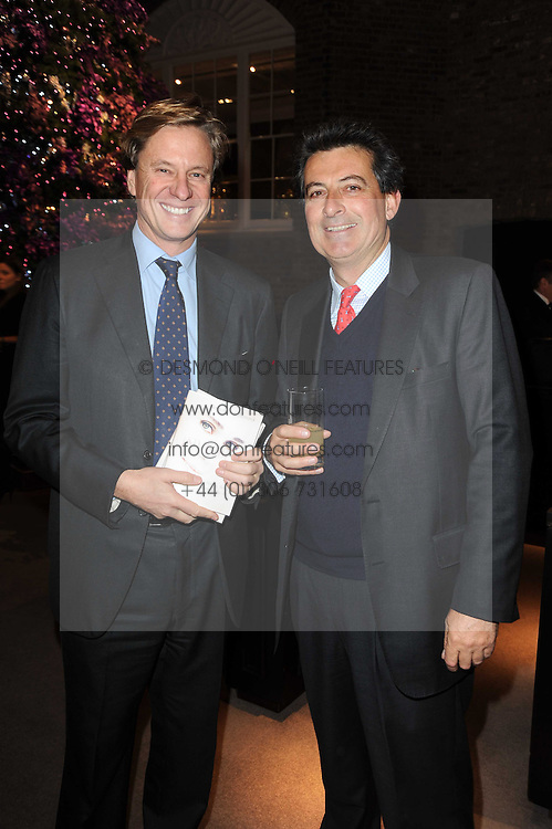 Left to right, ROB HERSOV and NICK BARHAM at a party to celebrate the publication of Nathalie von Bismarck's book 'Invisible' held at Asprey, 167 New Bond Street, London on 9th December 2010.