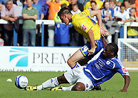 Peterboro Utd FC vs Sheffield Wednesday FC Championship 15/08/09<br /> Photo Nicky Hayes/Fotosports International<br /> Posh striker Aaron McLean slides in on Wednesday's Darren Potter.