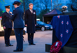 © London News Pictures. 25/04/2016. London, UK. Prince Harry attended a poignant ANZAC Day service at Hyde Park Corner at day break..The service began with the primitive sounds putatara conch shell trumpet playing a lament from the top of Royal Artillery Memorial. Photo credit: Sergeant Rupert Frere/LNP