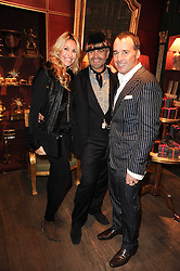 Left to right, MELISSA ODABASH, MARTYN LAWRENCE BULLARD and DAVID FURNISH at an exclusive viewing of Martyn Lawrence Bullard's furniture at Guinevere Antiques, 578 King's Road, London on 27th September 2010.