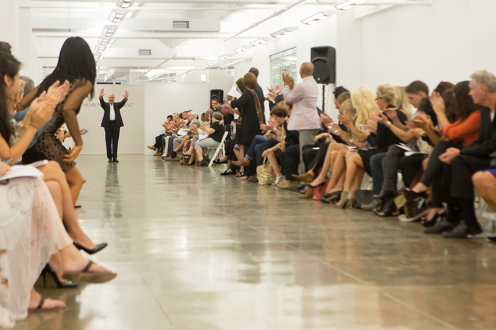 Carmen Marc Valve greets guests at the end his show at Spring 2013 Fashion Week in New York.