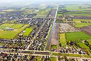 Nederland, Overijssel, Dedemsvaart, 01-05-2013; overzicht vanuit het Westen met<br /> zicht op de Hoofdvaart (water deels gedempd). Voormalige veenkolonie.<br /> Canals of former peatland 'colony'.<br /> luchtfoto (toeslag op standard tarieven);<br /> aerial photo (additional fee required);<br /> copyright foto/photo Siebe Swart
