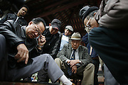 "Hanoi, Vietnam. March 11th 2007..Vietamese men play a traditional game in .""Ngoc Son"", the temple of Jade's mountain"