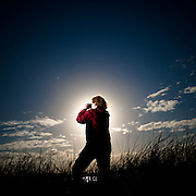 Tracey Valenzisi watching for birds at the Fivebough Wetlands, Leeton, NSW, Australia