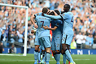 Frank Lampard of Man city 'celebrates' with his teammates after he scores his sides 1st goal to make it 1-1. Barclays premier league match, Manchester city v Chelsea at the Etihad stadium in Manchester,Lancs on Sunday 21st Sept 2014<br /> pic by Andrew Orchard, Andrew Orchard sports photography.