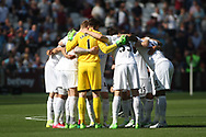 Swansea city team huddle ahead of  kick off. Premier league match, West Ham Utd v Swansea city at the London Stadium, Queen Elizabeth Olympic Park in London on Saturday 8th April 2017.<br /> pic by Steffan Bowen, Andrew Orchard sports photography.