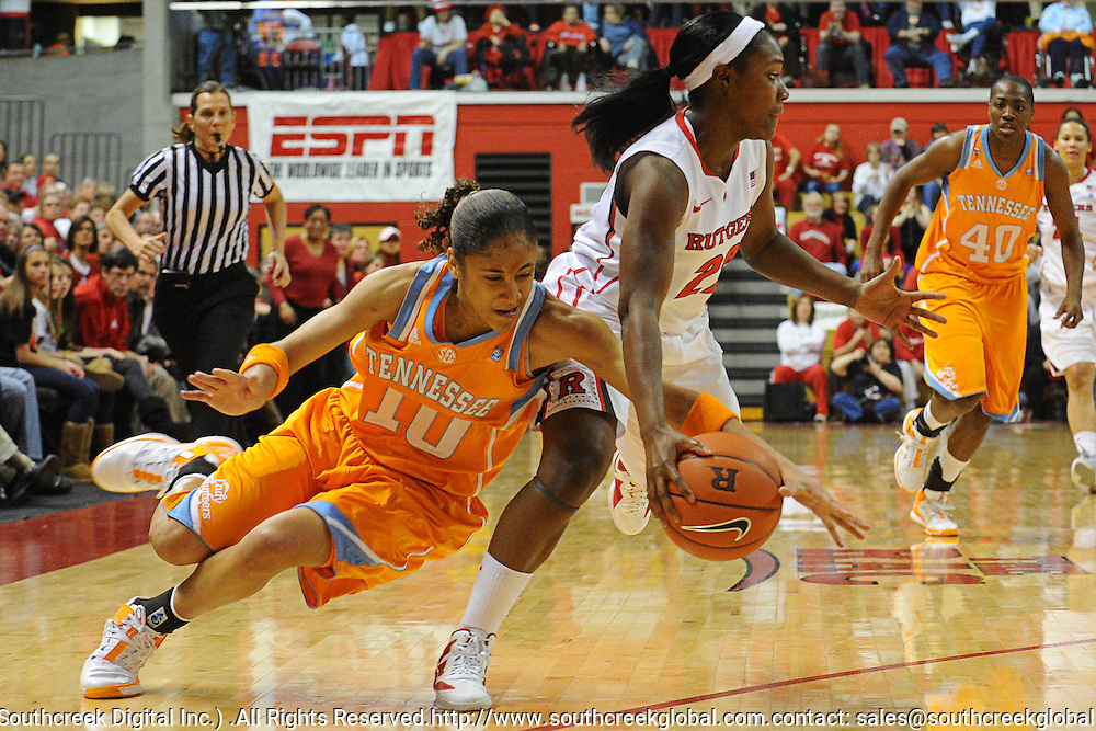 Tennessee Lady Volunteers guard Meighan Simmons (10) dives to knock the ball away from Rutgers Scarlet Knights guard Shakena Richardson (22) during first half NCAA Women's Basketball action between the Rutgers Scarlet Knights and Tennessee Lady Volunteers at the Louis Brown Athletic Center. Tennessee leads 33-28 at halftime.