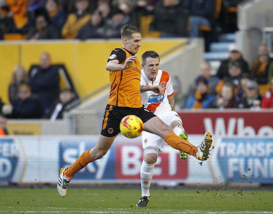 Blackpool's Peter Clarke battles with  Wolverhampton Wanderers David Edwards<br /> <br /> Photographer Mick Walker/CameraSport<br /> <br /> Football - The Football League Sky Bet Championship - Wolverhampton Wanderers v Blackpool - Saturday 17th January 2015 - Molineux - Wolverhampton<br /> <br /> © CameraSport - 43 Linden Ave. Countesthorpe. Leicester. England. LE8 5PG - Tel: +44 (0) 116 277 4147 - admin@camerasport.com - www.camerasport.com