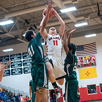 121814       Cable Hoover<br /> <br /> Grants Pirate Keegan Stewart (11) leaps past the Thoreau Hawks defense during the first round of the Eddie Pena Holiday Classic Thursday at Grants High School.