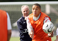 Photo: Chris Ratcliffe.<br />England training session. 06/06/2006.<br />Jermaine Jenas holds the ball in front of Sven Goran Eriksson.