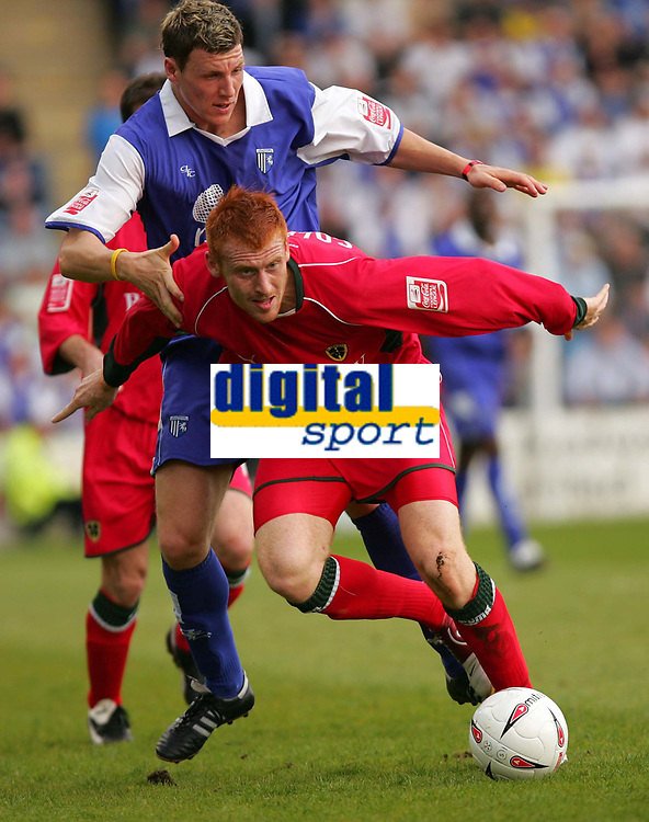 Photo:  Frances Leader.<br /> Gillingham FC v Cardiff City FC. Coca Cola Championship. <br /> Priestfield Stadium<br /> 30/04/05<br /> Cardiff's James Collins leads with the ball against Gillingaham's Darius Henderson.