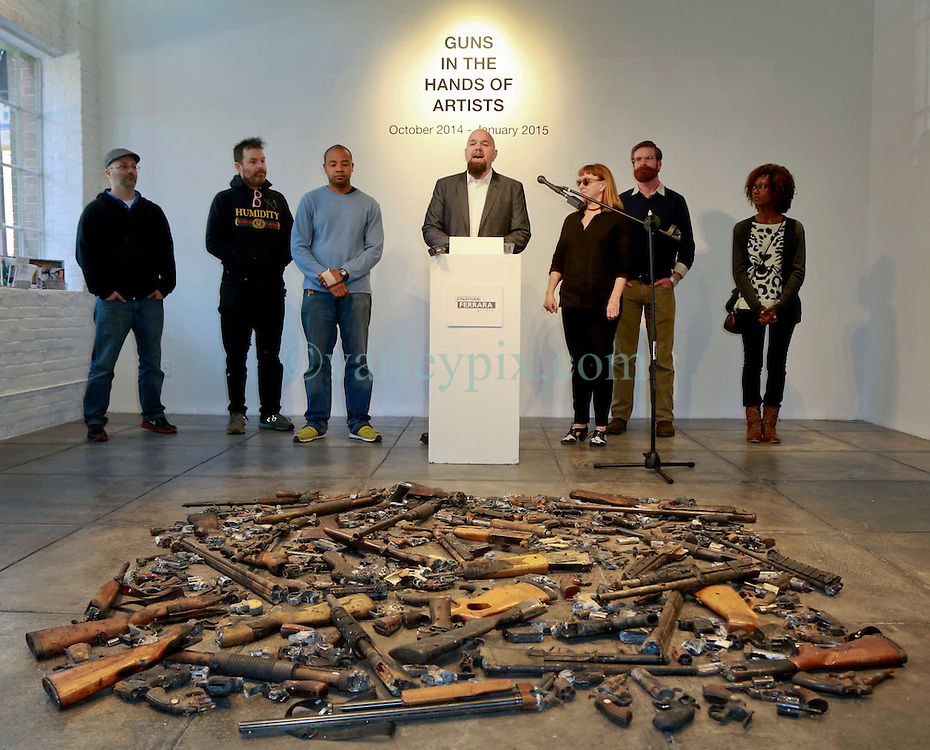 16 April 2014. Jonathan Ferrara Gallery, New Orleans, Louisiana. <br /> L/R; Artists Dan Tague, Skyler Fein, John Barnes, Jonathan Ferrara, Debora Luster, Adam Mysock and Katrina Andry at the Jonathan Ferrara Gallery to announce the 'Guns In The Hands Of Artists' project where artists take parts from 190 destroyed weapons acquired by the New Orleans Police department through a buy-back program and convert them into art.  <br /> Photo; Charlie Varley/varleypix.com