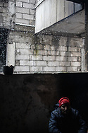 A man from Afghanistan is seen in a makeshift shelter during an heavy snowfall. A group of more than a hundred are living in an abandoned factory in Bihac waiting to try 'the game', as migrants call their attempts to cross the Bosnian Croatian border. January 25, 2021.
