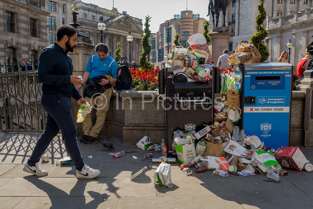 Untypical overflowing rubbish and litter collects over bins and recycling receptacles in Bank Triangle in the City of London - the capitals financial district aka The Square Mile, on 19th April 2018, in London, England.