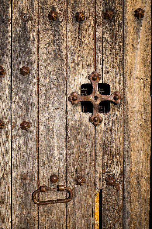 "Door of the 15-16th century Chapel of Sant Jaume de la Mata, in Mura, near the Coll d'Estenalles in Parc Natural de Sant Llorenç del Munt i l'Obac, Barcelona, Catalonia. This mage can be licensed via Millennium Images. Contact me for more details, or email mail@milim.com For prints, contact me, or click ""add to cart"" to some standard print options."