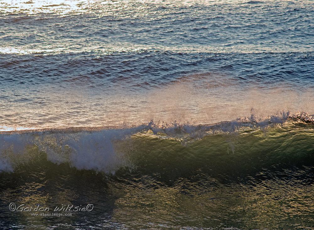 Pacific Ocean waves roll ashore along the California coast near San Francisco.