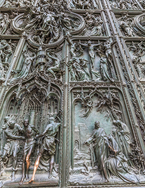 The front door of the cathedral of Milan, Italy. This door is dedicated to the Virgin Mary and each of their boxes has a biblical chapter that refers to the life of the Virgin.