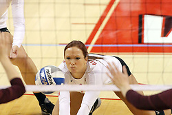 07 November 2014:  Sierra Burris lunges forward to get a dig during an NCAA womens volleyball match between the Loyola Ramblers and the Illinois State Redbirds at Redbird Arena in Normal IL