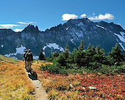 Hike on Sahale Arm above Cascade Pass in North Cascades National Park, Washington, USA. The Triplets are the sharp peaks on the left, and Cascade Peak is on the right.