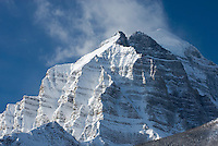 Clouds and snow blowing off the summit of Mount Temple on a cold winter morning, Banff National Park Alberta Canada