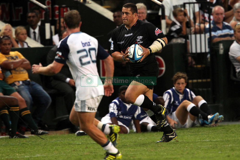 Eugene van Staden attacks for the Sharks during the Super15 match between The Mr Price Sharks and The Blues held at Mr Price Kings Park Stadium in Durban on the 26th February 2011..Photo By:  Ron Gaunt/SPORTZPICS
