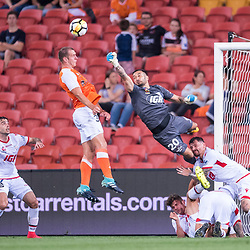 BRISBANE, AUSTRALIA - OCTOBER 13: Paul Izzo of Adelaide defends the headed ball of Luke DeVere of the Roar during the Round 2 Hyundai A-League match between Brisbane Roar and Adelaide United on October 13, 2017 in Brisbane, Australia. (Photo by Patrick Kearney)