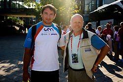 Team leader Marjan Hudej (R) and World Champion Primoz Kozmus of Slovenia at departure back to Slovenia during day five of the 12th IAAF World Athletics Championships at the Hotel Estrel on August 18, 2009 in Berlin, Germany. (Photo by Vid Ponikvar / Sportida)