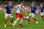 Kacper Kozlowski holds off Connor Barron (Aberdeen)  during the U17 European Championships match between Scotland and Poland at Firhill Stadium, Maryhill, Scotland on 26 March 2019.